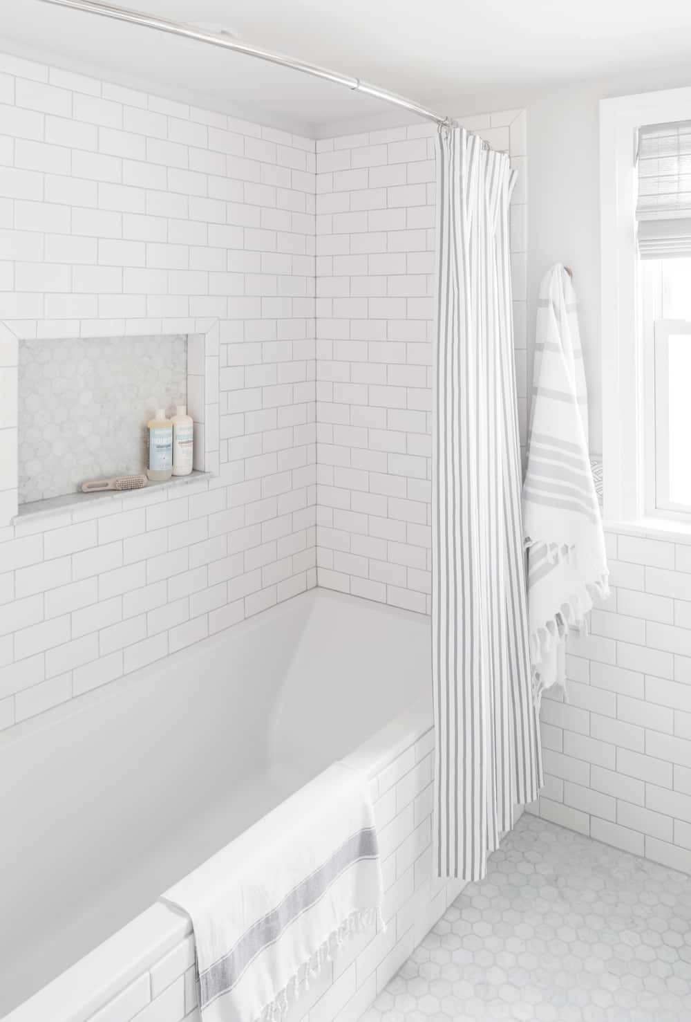 Small bathroom renovation white subway tile centered by - Small bathroom remodel with tub ...