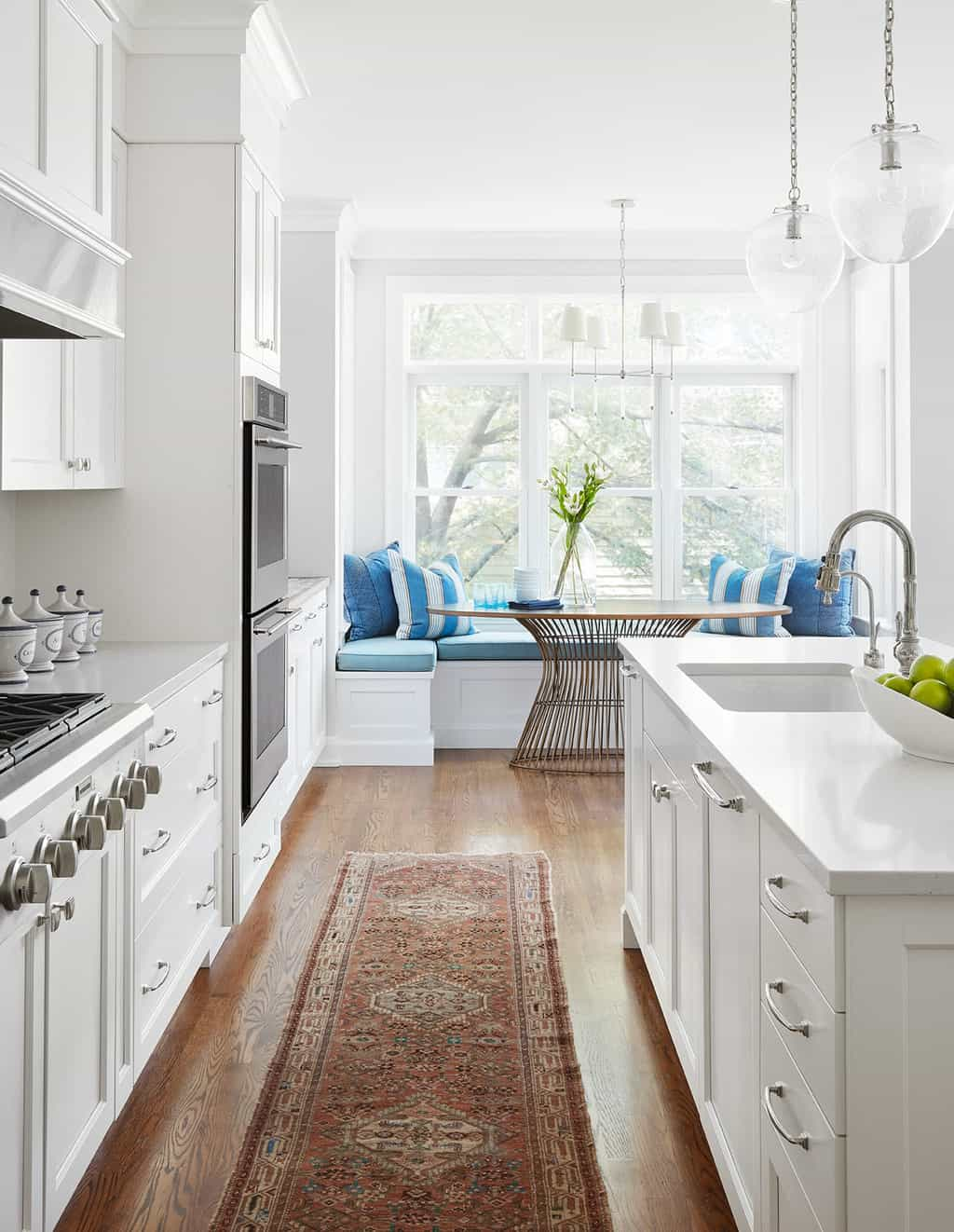 modern white kitchen with breakfast table