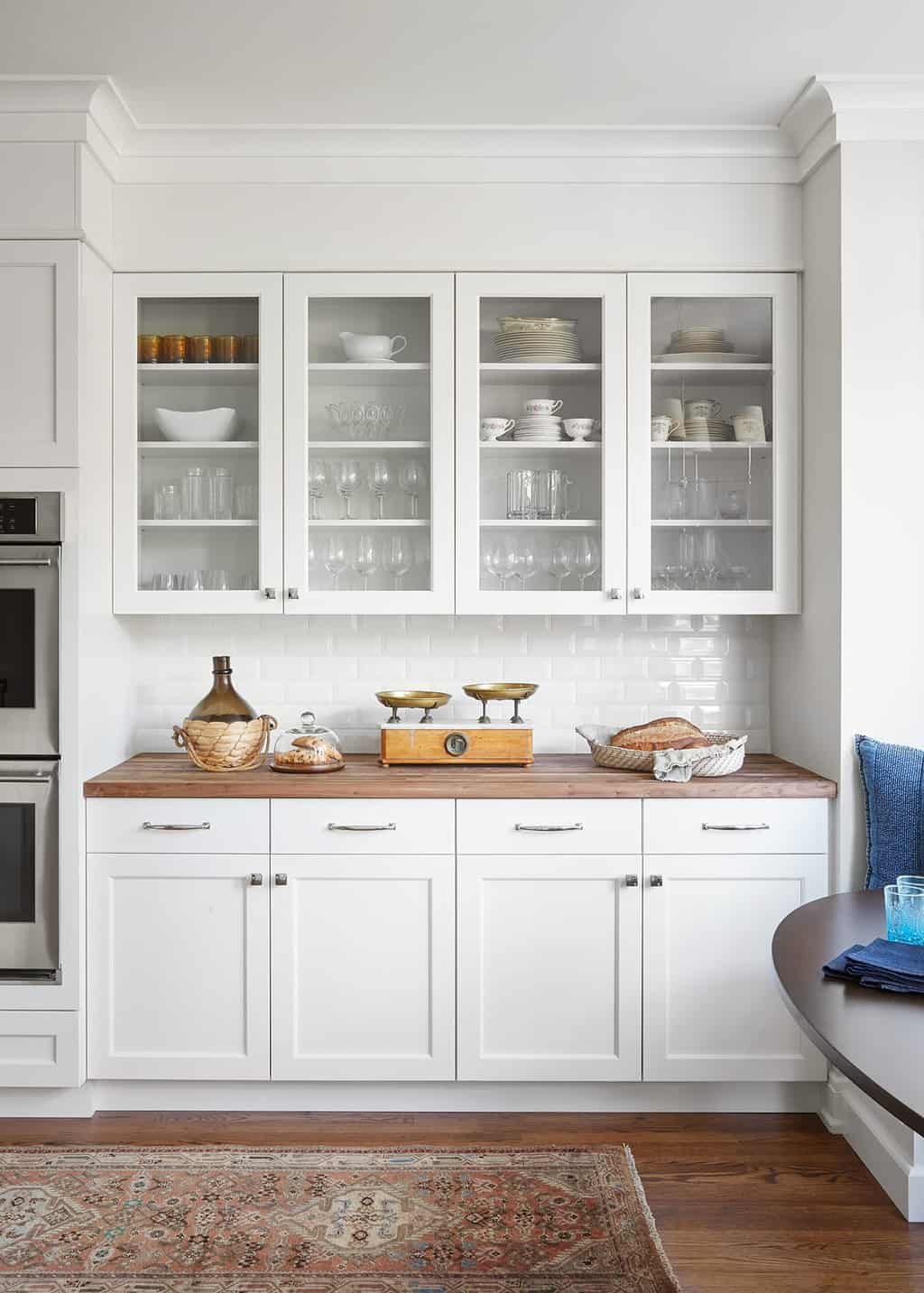glass front white cabinets butcher block counter