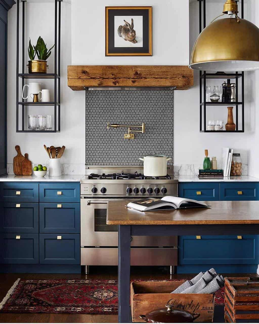 blue kitchen cabinets and tiled stove backsplash in an eclectic kitchen