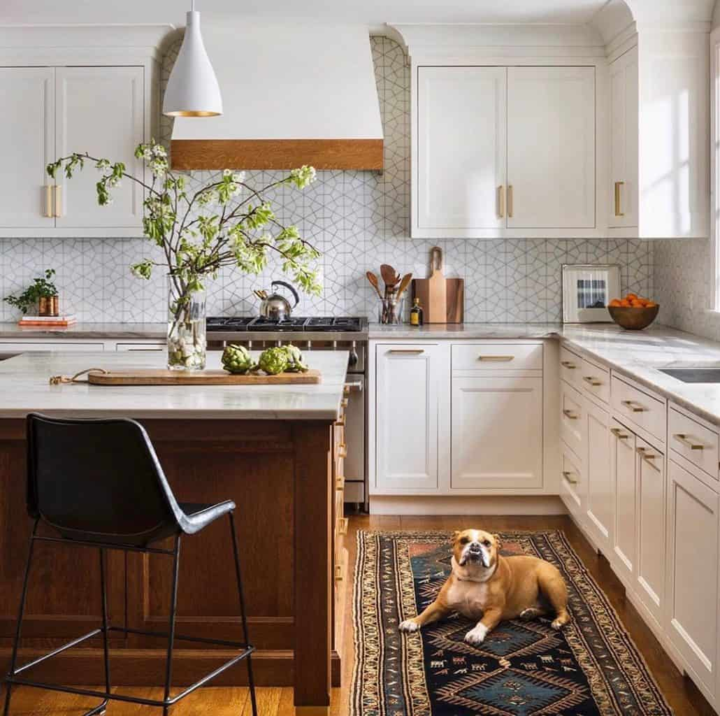 white kitchen cabinets with wood island and vintage runner