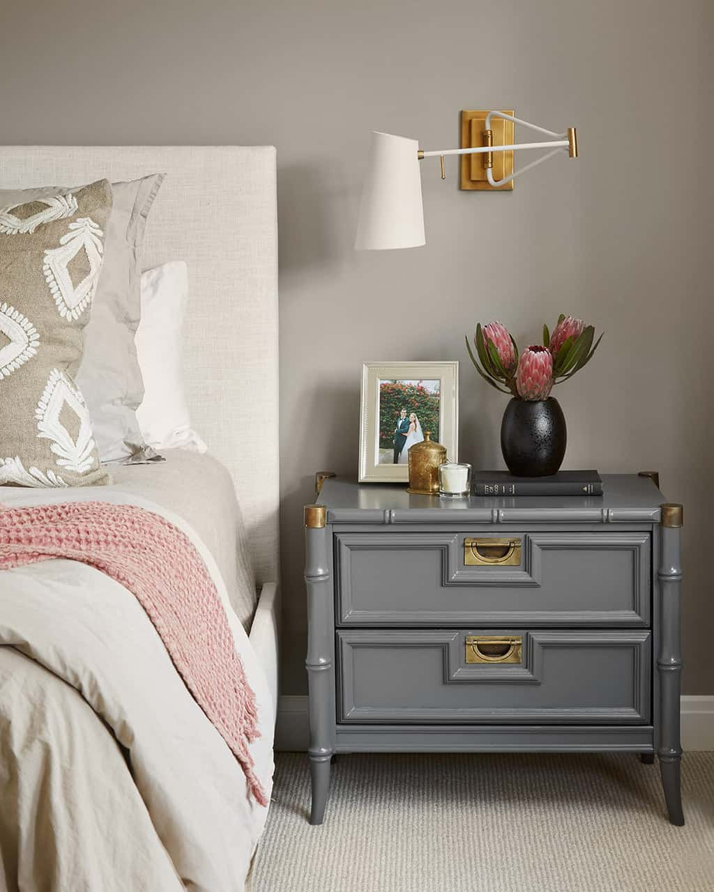bedroom with gray nightstand